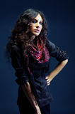 Portrait of a beautiful lady with flowered scarf. And long curly hair royalty free stock photography