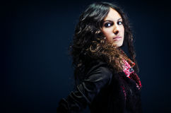 Portrait of a beautiful lady with flowered scarf. And long curly hair royalty free stock image