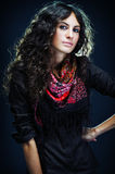 Portrait of a beautiful lady with flowered scarf. And long curly hair stock image
