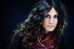 Portrait of a beautiful lady with flowered scarf. And long curly hair stock photos