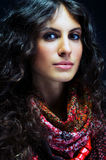 Portrait of a beautiful lady with flowered scarf. And long curly hair Royalty Free Stock Photo