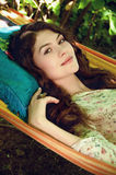 Portrait of beautiful lady in the garden hammock, spring or summ Royalty Free Stock Photography