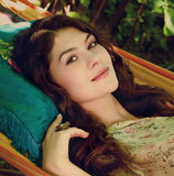 Portrait of beautiful lady in the garden hammock, spring or summ Stock Images