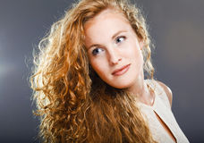 Portrait of beautiful lady on grey Royalty Free Stock Images