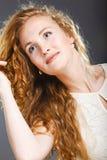 Portrait of beautiful lady on grey. Royalty Free Stock Photo
