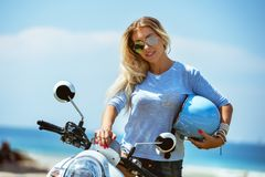 Beautiful lady with helmet and scooter royalty free stock image