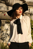 Portrait of beautiful ladylike woman wearing elegant blouse  and hat Royalty Free Stock Photos