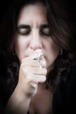 Portrait of a beautiful latin woman kissing a crucifix Stock Image