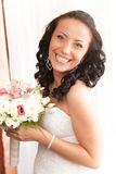 Portrait of beautiful laughing brunette bride Stock Image