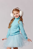 Portrait of beautiful laughing girl in a blue skirt and fur head Royalty Free Stock Image