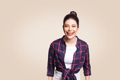 Portrait of beautiful laughing happy girl in casual style looking at camera and laughing. Royalty Free Stock Images