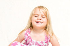 Portrait of Beautiful Laughing Toddler Girl Eyes Closed. Closeup Portrait of Beautiful Laughing Toddler Girl Eyes Closed Neutral Background Royalty Free Stock Photography