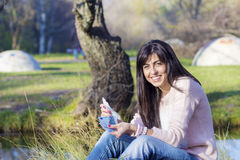 Portrait of beautiful laughing woman counting her  money in the park Royalty Free Stock Photos