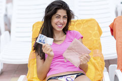 Portrait of beautiful laughing woman with wallet and bill in the hands Royalty Free Stock Images