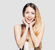 Portrait of beautiful laughing young woman. Closeup portrait of beautiful young woman Royalty Free Stock Image