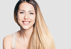 Portrait of beautiful laughing young woman. Closeup portrait of beautiful young woman Royalty Free Stock Images
