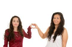 Portrait of beautiful lesbian couple in love. Vportrait of beautiful lesbian couple in love making a heart shape with their hands isolated on white Stock Image