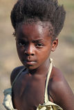 portrait of a beautiful little African girl standing at the train station Stock Photos