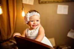 Portrait of a beautiful little baby. Close-up. Portrait of a beautiful little baby in pink dress and . Close-up stock photography