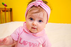Portrait of a beautiful little baby girl with a bandage on his head. Portrait of a beautiful little baby Stock Images