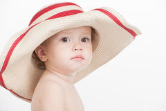 Portrait of Beautiful little baby girl in summer hat. Stock Photos