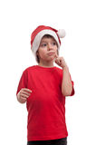 Portrait of beautiful little boy in hat of Santa Claus with finger on his cheek isolated on white background Stock Images