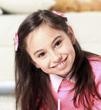 Portrait of a beautiful little girl on the background of childre Royalty Free Stock Images