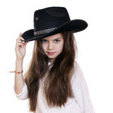 Portrait of a beautiful little girl in a black cowboy hat Stock Photos