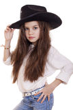 Portrait of a beautiful little girl in a black cowboy hat Royalty Free Stock Image