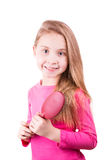 Portrait of a beautiful little girl brushing her long  hair. Hair care concept. Royalty Free Stock Photography