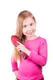 Portrait of a beautiful little girl brushing her long  hair. Hair care concept. Stock Photography