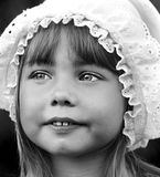 Portrait of a beautiful little girl in cap. Black and white portrait of a beautiful little girl in old -fashioned lace cap Stock Images