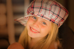 Portrait of a beautiful little girl in a cap close up Stock Image