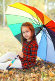 Portrait beautiful little girl child with colorful umbrella in autumn Stock Images