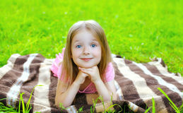 Portrait of beautiful little girl child lying resting Stock Photos