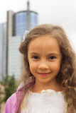 Portrait of a beautiful little girl close-up. Portrait of a beautiful little girl with curly hair close-up Stock Image