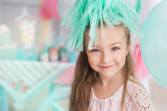 Portrait of a beautiful little girl in a colorful room. A Portrait of a beautiful little girl in a room decorated a colorful colors Stock Photo