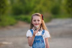 Cportrait of a beautiful little girl  with dandelion Stock Photos