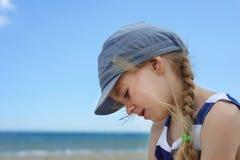 Portrait of beautiful little girl in denim hat Stock Image