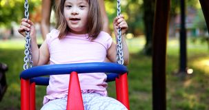 Portrait of beautiful little girl with down syndrome Stock Photos