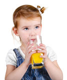 Portrait of beautiful little girl drinking a juice Royalty Free Stock Photo