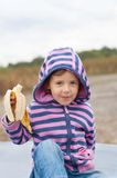 Portrait of a beautiful little girl eating banana Royalty Free Stock Images