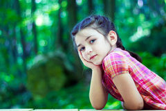 Portrait of a beautiful little girl in the forest Royalty Free Stock Photography