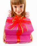 Portrait of a beautiful little girl with gifts in his hands. Royalty Free Stock Image