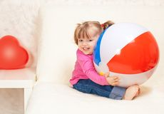Portrait of a beautiful little girl holding a ball Stock Images