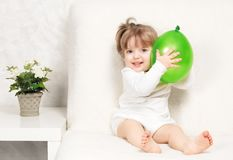 Portrait of a beautiful little girl holding a ball Royalty Free Stock Images