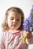 Portrait of a beautiful little girl holding flowers Royalty Free Stock Image