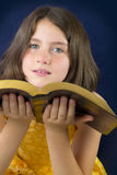 Portrait of beautiful little girl holding Holy Bible Stock Photo