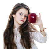 Portrait of a beautiful little girl holding a red apple Stock Image