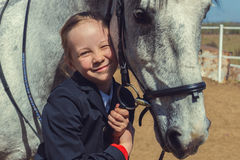 Portrait of a beautiful little girl with a horse. Young rider Stock Images